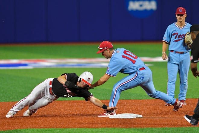 North Carolina State's JT Jarrett (15) is tagged out by Louisiana Tech shortstop Logan McLeod (10) during the NCAA regional final Sunday June 6, 2021 at J.C. Love Field at Pat Patterson Park.